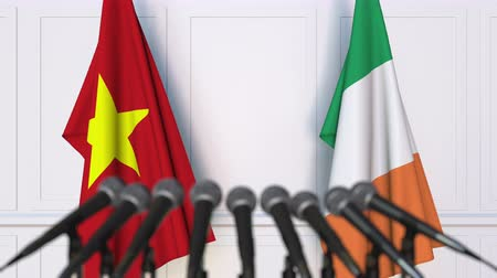 вьетнамский : Flags of Vietnam and Ireland at international meeting or negotiations press conference. 3D animation