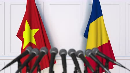 rumena : Flags of Vietnam and Romania at international meeting or negotiations press conference. 3D animation