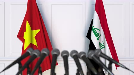 утверждение : Flags of Vietnam and Iraq at international meeting or negotiations press conference. 3D animation