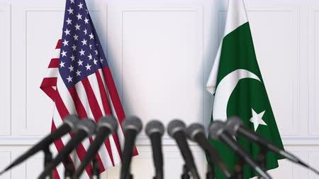 Пакистан : Flags of the United States and Pakistan at international meeting or negotiations press conference. 3D animation