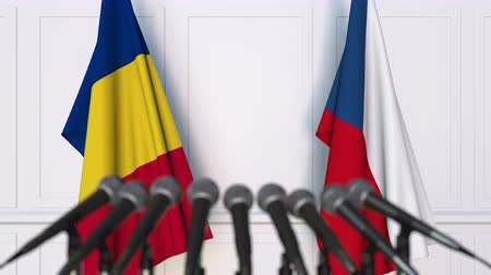 romeno : Flags of Romania and the Czech Republic at international meeting or negotiations press conference. 3D animation