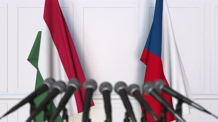 венгерский : Flags of Hungary and the Czech Republic at international meeting or negotiations press conference. 3D animation