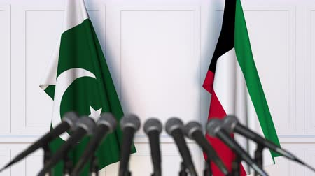paquistão : Flags of Pakistan and Kuwait at international meeting or negotiations press conference. 3D animation