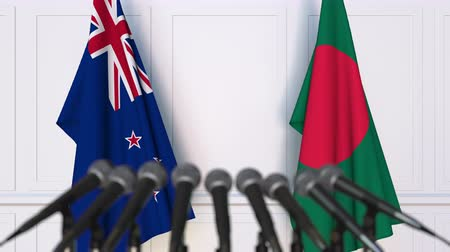nowa zelandia : Flags of New Zealand and Bangladesh at international meeting or negotiations press conference. 3D animation Wideo
