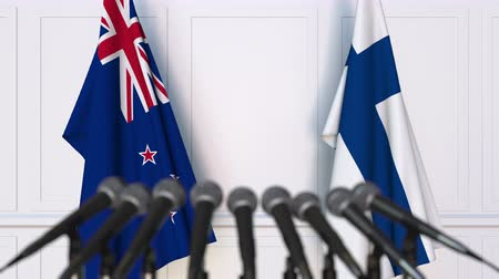 nowa zelandia : Flags of New Zealand and Finland at international meeting or negotiations press conference. 3D animation