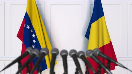 romeno : Flags of Venezuela and Romania at international meeting or negotiations press conference. 3D animation