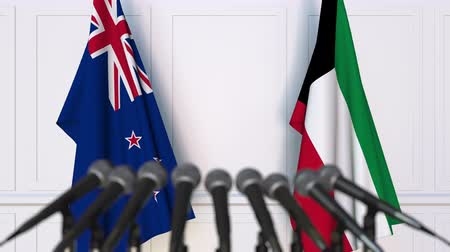 nowa zelandia : Flags of New Zealand and Kuwait at international meeting or negotiations press conference. 3D animation