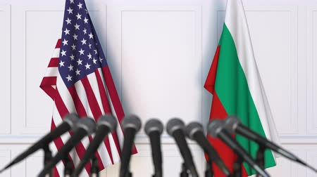 press conference : Flags of the United States and Bulgaria at international meeting or negotiations press conference. 3D animation