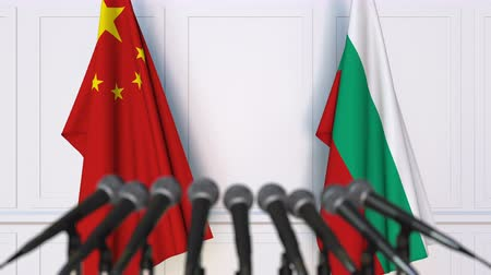 búlgaro : Flags of China and Bulgaria at international meeting or negotiations press conference. 3D animation
