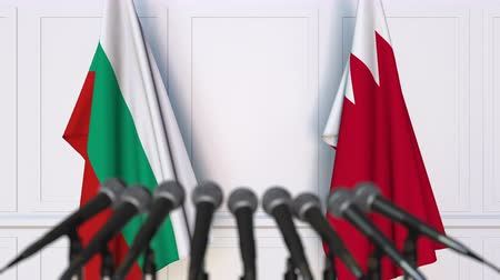 búlgaro : Flags of Bulgaria and Bahrain at international meeting or negotiations press conference. 3D animation