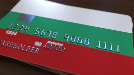 дебет : Plastic card with flag of Bulgaria. Bulgarian banking system conceptual 3D animation Стоковые видеозаписи