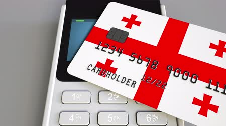 дебет : Paying with plastic card with flag of Georgia. Georgian retail sales or banking conceptual 3D animation