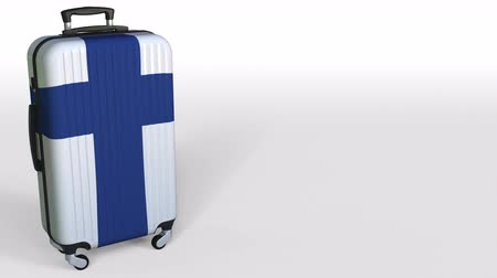 キャプション : Travelers suitcase with flag of Finland. Finnish tourism conceptual 3D rendering, blank space for caption