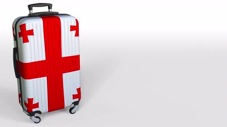 キャプション : Travelers suitcase with flag of Georgia. Georgian tourism conceptual 3D animation, blank space for caption