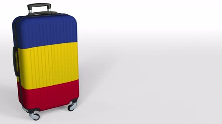 rumena : Travelers suitcase with flag of Romania. Romanian tourism conceptual 3D animation, blank space for caption