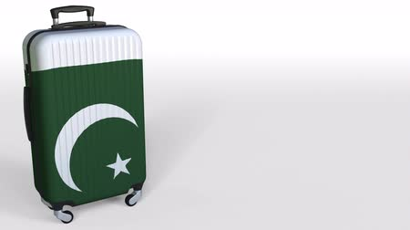 lehká váha : Travelers suitcase with flag of Pakistan. Pakistani tourism conceptual 3D animation, blank space for caption Dostupné videozáznamy