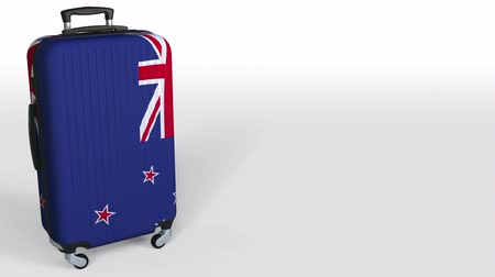 nowa zelandia : Travelers suitcase with flag of New Zealand. Tourism conceptual 3D animation, blank space for caption