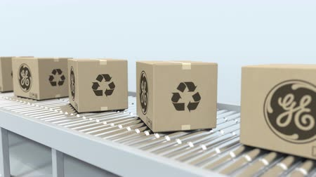 general electric : Boxes with GENERAL ELECTRIC logo move on roller conveyor. Loopable editorial 3D animation