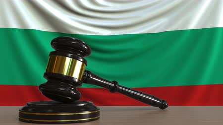adli : Judges gavel and block against the flag of Bulgaria. Bulgarian court conceptual animation