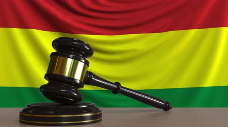 licit : Judges gavel and block against the flag of Bolivia. Bolivian court conceptual animation