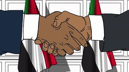 muhalefet : Businessmen or politicians shaking hands against flags of Sudan. Meeting or cooperation related cartoon animation