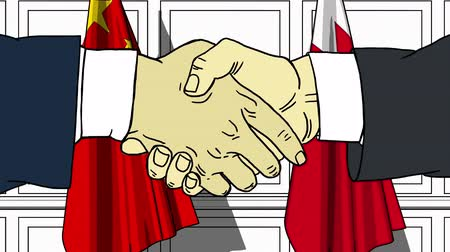 politicians : Businessmen or politicians shake hands against flags of China and Bahrain. Official meeting or cooperation related cartoon animation