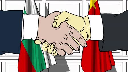 человеческая рука : Businessmen or politicians shake hands against flags of Bulgaria and China. Official meeting or cooperation related cartoon animation Стоковые видеозаписи
