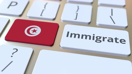 tunus : IMMIGRATE text and flag of Tunisia on the buttons on the computer keyboard. Conceptual 3D animation