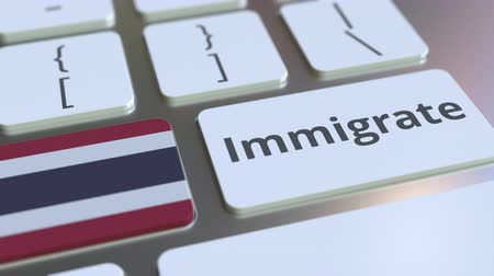 settlement : IMMIGRATE text and flag of Thailand on the buttons on the computer keyboard. Conceptual 3D animation