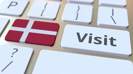 usuário : VISIT text and flag of Denmark on the buttons on the computer keyboard. Conceptual 3D animation