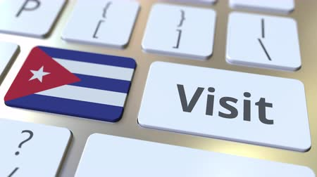 yabancı : VISIT text and flag of Cuba on the buttons on the computer keyboard. Conceptual 3D animation Stok Video