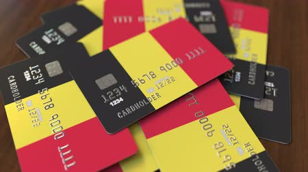 дебет : Pile of credit cards with flag of Belgium. Belgian banking system conceptual 3D animation
