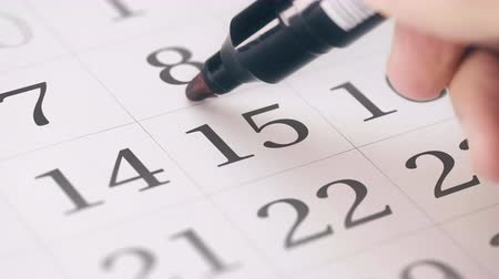 período : Marked the fifteenth 15 day of a month in the calendar transforms into SAVE THE DATE text