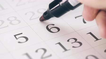 período : Marked the sixth 6 day of a month in the calendar transforms into SAVE THE DATE text