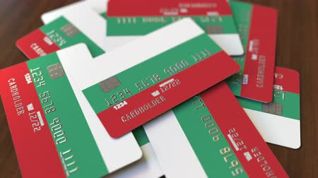 búlgaro : Pile of credit cards with flag of Bulgaria. Bulgarian banking system conceptual 3D animation