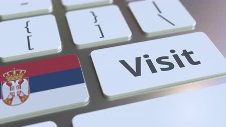 sérvia : VISIT text and flag of Serbia on the buttons on the computer keyboard. Conceptual 3D animation