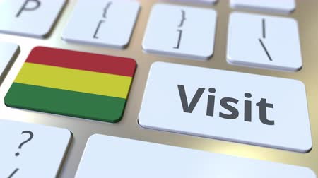 Боливия : VISIT text and flag of Bolivia on the buttons on the computer keyboard. Conceptual 3D animation Стоковые видеозаписи