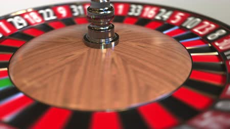 рулетка : Casino roulette wheel ball hits 3 three red. 3D animation Стоковые видеозаписи