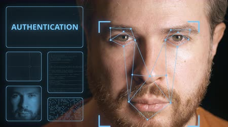 идентификация : Computer system scanning face of a man. Digital authentication related clip