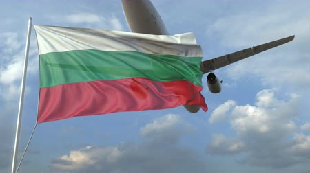 посадка : Airliner flying over waving flag of Bulgaria. 3D animation Стоковые видеозаписи