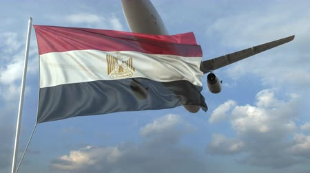 ayrılmak : Airliner flying over waving flag of Egypt. 3D animation