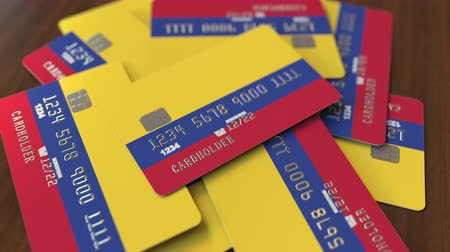 дебет : Pile of credit cards with flag of Colombia. Colombian banking system conceptual 3D animation