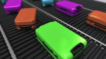 queue : Colorful suitcases move on roller conveyor in the airport. Loopable 3D animation