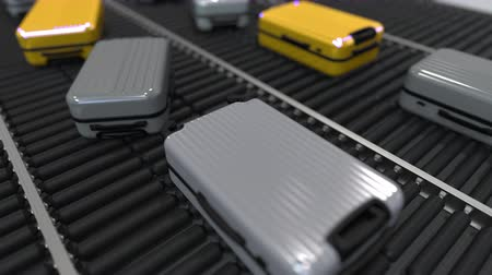 handling : Yellow and grey suitcases move on the conveyor. Loopable 3D animation
