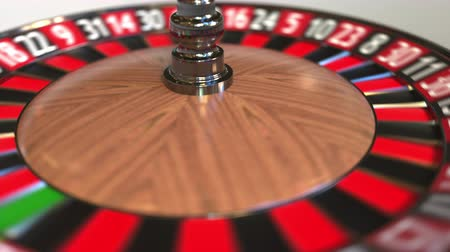 szektor : Casino roulette wheel ball hits 12 twelve red. 3D animation Stock mozgókép