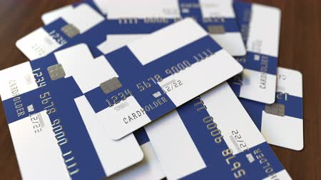 fince : Pile of credit cards with flag of Finland. Finnish banking system conceptual 3D animation