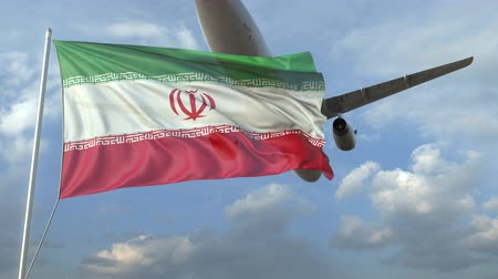 urlop : Airliner flying over waving flag of Iran. 3D animation Wideo