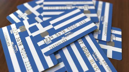 greece flag : Pile of credit cards with flag of Greece. Greek banking system conceptual 3D animation
