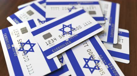 izrael : Pile of credit cards with flag of Israel. Israeli banking system conceptual 3D animation