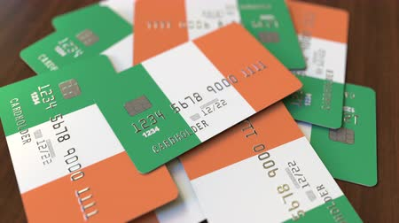 drapeau irlandais : Pile of credit cards with flag of Ireland. Irish banking system conceptual 3D animation